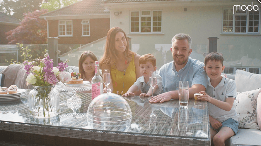 family gathered around moda dining table outdoors