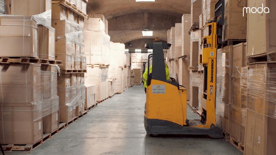 forklift truck operating inside moda warehouse